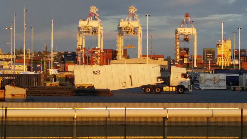 IOR Petroleum frac tank on truck at the Fremantle Harbour filled with many shipping containers near Perth